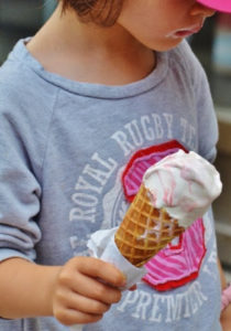 Child holding ice cream cone